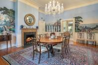 <p>Scenic wallpaper murals and a glittering chandelier harken back to the home's early days.</p>