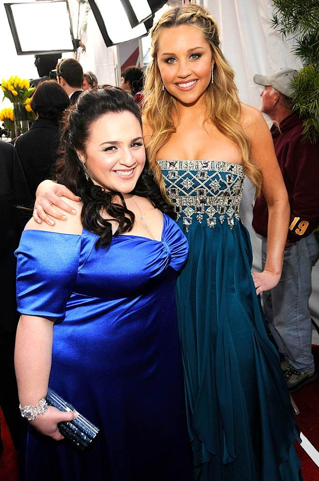 "Amanda Bynes towers over her ""Hairspray"" co-star Nikki Blonsky, who shows off her curves in a bright blue ensemble. While we love the color, we're not sure if the dress itself was the best choice for Nikki. Kevin Mazur/<a href=""http://www.wireimage.com"" target=""new"">WireImage.com</a> - January 27, 2008"