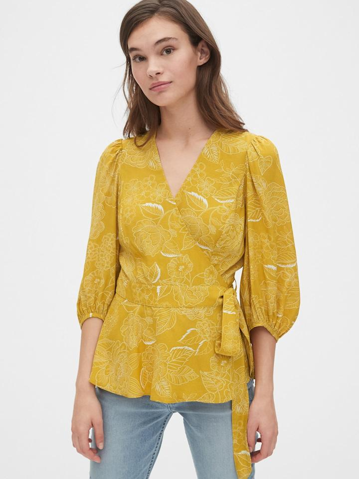 "<p>This gorgeous <a href=""https://www.popsugar.com/buy/Gap-Print-Wrap-Blouse-476734?p_name=Gap%20Print%20Wrap%20Blouse&retailer=gap.com&pid=476734&price=42&evar1=fab%3Aus&evar9=46467705&evar98=https%3A%2F%2Fwww.popsugar.com%2Fphoto-gallery%2F46467705%2Fimage%2F46467725%2FGap-Print-Wrap-Blouse&list1=shopping%2Cgap%2Ccurve%2Csummer%20fashion%2Ccurve%20fashion&prop13=api&pdata=1"" rel=""nofollow"" data-shoppable-link=""1"" target=""_blank"" class=""ga-track"" data-ga-category=""Related"" data-ga-label=""https://www.gap.com/browse/product.do?pid=494640002&amp;cid=8792&amp;pcid=8792&amp;grid=pds_20_152_1&amp;cpos=20&amp;cexp=1161&amp;cid=CategoryIDs%3D8792&amp;cvar=8259&amp;ctype=Listing&amp;cpid=res19080709929598012440650#pdp-page-content"" data-ga-action=""In-Line Links"">Gap Print Wrap Blouse</a> ($42, originally $60) is a great Summer to Fall transition piece.</p>"