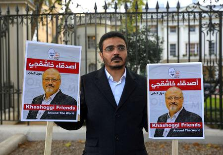 FILE PHOTO: People protest against the killing of journalist Jamal Khashoggi in Turkey outside the Saudi Arabian Embassy in London, Britain, October 26 2018. REUTERS/Simon Dawson/File Photo