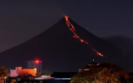 Lava cascades down the slopes of Mayon volcano as seen from Legazpi City, Albay province, 330 km southeast of Manila, in 2009. Asian countries dominate a league table of economies most at risk from earthquakes, floods, storms and other natural hazards, according to research published on Wednesday
