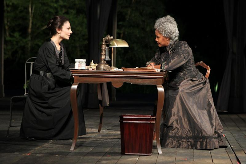 "In this theater publicity image released by The Public Theater, Annie Parisse, left, and Tonya Pinkins are shown in a scene from ""All's Well That Ends Well,""  in New York. (AP Photo/The Public Theater, Joan Marcus)"