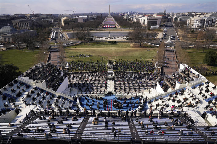 Guests and spectators attend the 59th Presidential Inauguration for President Joe Biden at the U.S. Capitol in Washington, Wednesday, Jan. 20, 2021. (AP Photo/Susan Walsh, Pool)