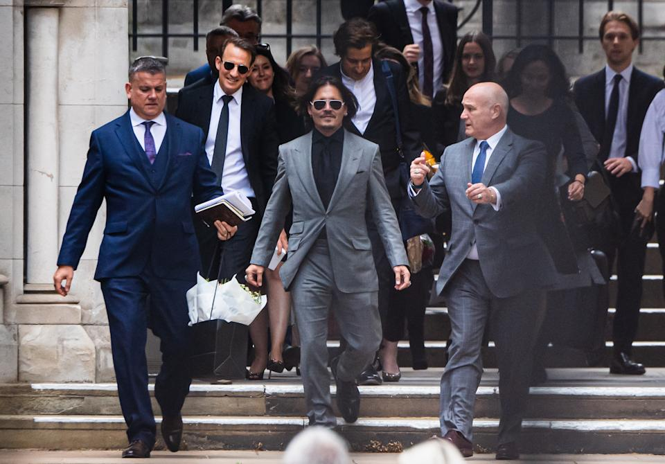 LONDON, ENGLAND - JULY 28:  Johnny Depp leaves the Royal Courts of Justice, Strand on July 28, 2020 in London, England. The Hollywood Actor is suing News Group Newspapers (NGN) and the Sun's executive editor, Dan Wootton, over an article published in 2018 that referred to him as a