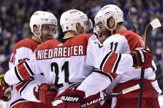 Carolina Hurricanes center Jordan Staal (11) celebrates his goal against Toronto Maple Leafs goaltender Garret Sparks with teammates during the third period of an NHL hockey game, Tuesday, April 2, 2019, in Toronto. Carolina Hurricanes right wing Nino Niederreiter (21) picked up an assist on the play. (Frank Gunn/The Canadian Press via AP)