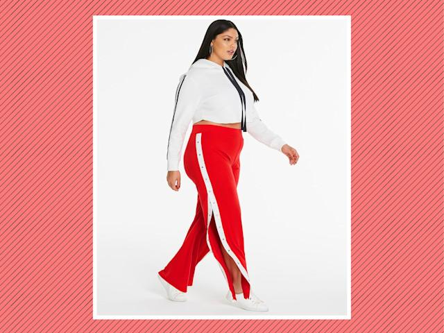 "<p>Side Strip Popper Trousers, $46, <a href=""https://www.simplybe.com/en-us/products/sbu-popper-trousers/p/WZ585#v=color%3AWZ585_RED%2FIVORY%7C"" rel=""nofollow noopener"" target=""_blank"" data-ylk=""slk:Simply Be"" class=""link rapid-noclick-resp"">Simply Be </a>(Photo: Simply Be) </p>"