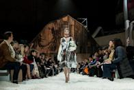 <p>Did anyone else notice FROW attendees stumbling to their seats over the popcorn-laden runway? For his second stint at the label, Raf Simons seemingly referenced the current climate in America.<br>The set featured run-down barns plastered in artwork by Andy Warhol. While the sea of popcorn seemingly referenced burned-down cornfields. And if that wasn't subtle enough, David Bowie's 'This Is Not America' played during the finale. <em>[Photo: Getty] </em> </p>