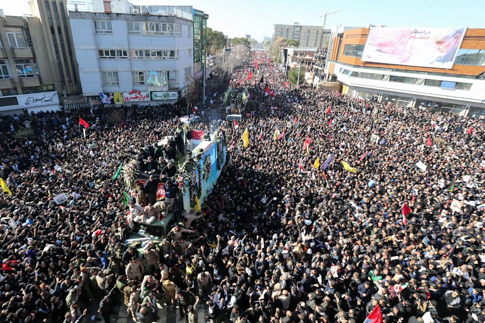 Iranian mourners gather around a vehicle carrying the coffin of slain top general Qasem Soleimani during the final stage of funeral processions, in his hometown Kerman on January 7, 2020. (Atta Kenare/AFP via Getty Images)