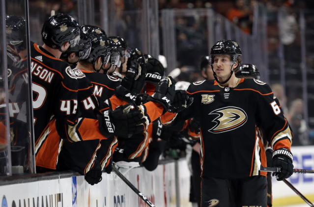 Anaheim Ducks' Rickard Rakell, right, celebrates his goal with teammates during the first period of an NHL hockey game Friday, March 22, 2019, in Anaheim, Calif. (AP Photo/Marcio Jose Sanchez)