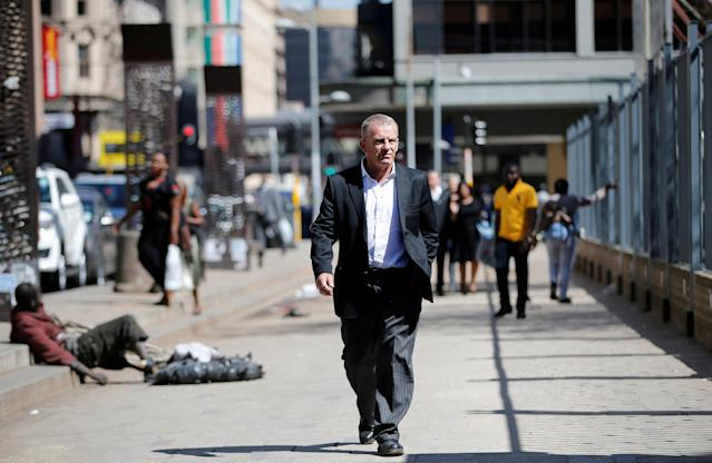 FILE PHOTO - State prosecutor Gerrie Nel arrives for an appeal hearing brought by prosecutors against the six-year jail term handed to Oscar Pistorius for the murder of his girlfriend Reeva Steenkamp in Johannesburg, South Africa August 26, 2016. REUTERS/Siphiwe Sibeko/File Photo