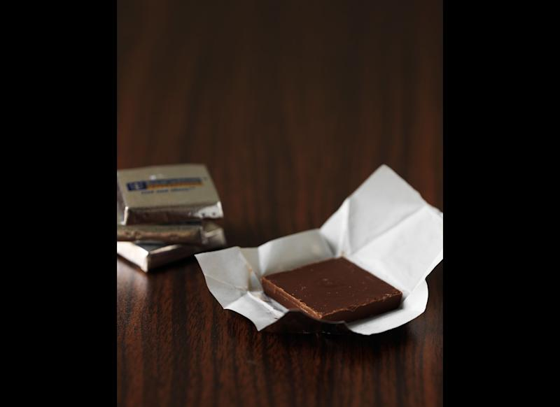 "Dark chocolate doesn't only have health benefits for the heart -- eating it can also help to <a href=""http://www.livescience.com/7974-chocolate-reduces-stress-study-finds.html"" target=""_hplink"">lower stress</a>. LiveScience reported on a study illustrating that eating 1.4 ounces of <a href=""http://www.livescience.com/7974-chocolate-reduces-stress-study-finds.html"" target=""_hplink"">dark chocolate</a> a day for a two-week period is linked with decreased levels of the stress hormone cortisol. That study was published in 2009 in the journal <em>Proteome Research</em>. (But of course, chocolate still contains sugar and lots of calories, so make sure you eat it in moderation!) Drinking tea has also been shown to <a href=""http://www.medicalnewstoday.com/articles/160668.php"" target=""_hplink"">reduce stress</a> and may be a more healthy alternative."