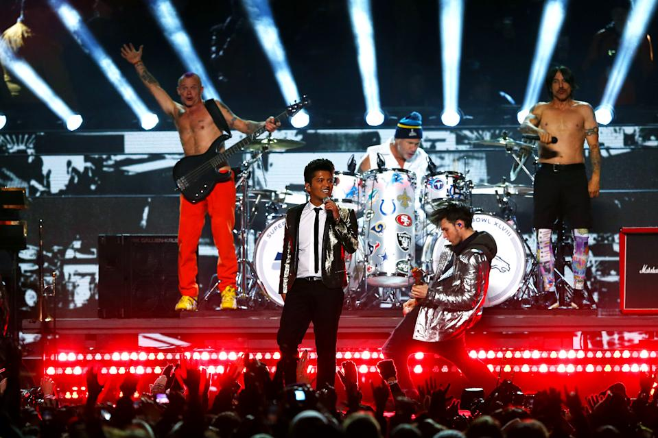 Bruno Mars peforms withe the Red Hot Chili Peppers during the Pepsi Super Bowl XLVIII Halftime Show at MetLife Stadium on February 2, 2014 in East Rutherford, New Jersey. (Photo by Elsa/Getty Images)