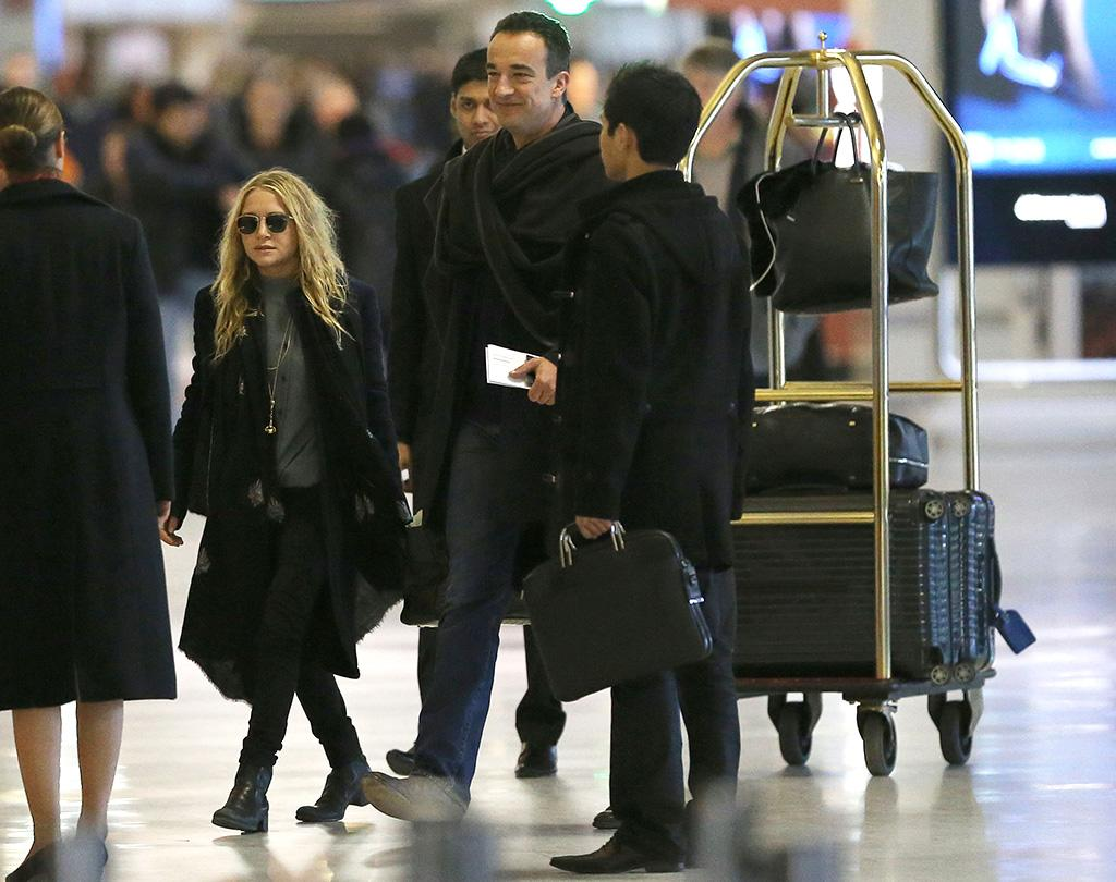 Exclusive... 50984050 Actress and fashionista Mary-Kate Olsen departing on a flight at Roissy airport in Paris, France with her much older French boyfriend Olivier Sarkozy on January 6th, 2013. The happy couple aren't afraid to show some PDA while they wait for their flight. No Internet Use Without Prior Agreement  FameFlynet, Inc - Beverly Hills, CA, USA -  1 (818) 307-4813 RESTRICTIONS APPLY: USA/AUSTRALIA ONLY