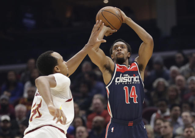 Washington Wizards' Ish Smith (14) shoots over Cleveland Cavaliers' John Henson (31) in the first half of an NBA basketball game, Thursday, Jan. 23, 2020, in Cleveland. (AP Photo/Tony Dejak)