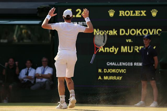 LONDON, ENGLAND - JULY 07: Andy Murray of Great Britain celebrates Championship point during the Gentlemen's Singles Final match against Novak Djokovic of Serbia on day thirteen of the Wimbledon Lawn Tennis Championships at the All England Lawn Tennis and Croquet Club on July 7, 2013 in London, England. (Photo by Clive Brunskill/Getty Images)