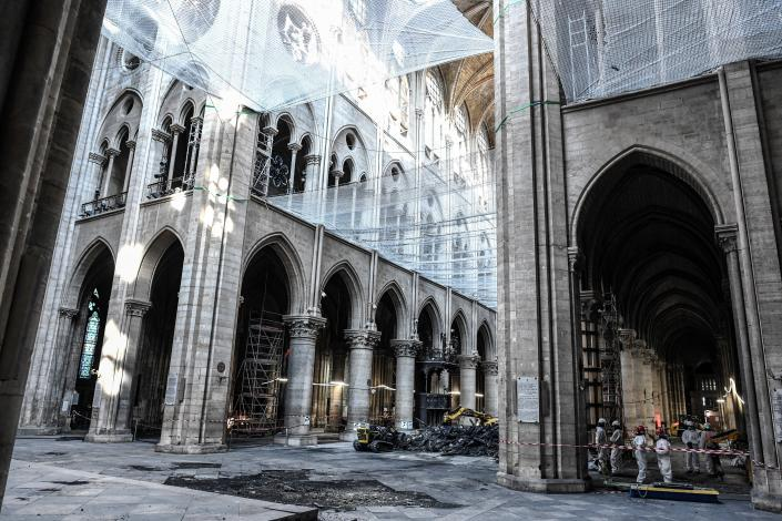 Damage on the nave and rubble are seen during preliminary work in the Notre Dame Cathedral three months after a major fire July 17, 2019 in Paris. (Photo: Stephane de Sakutin/Pool via AP)