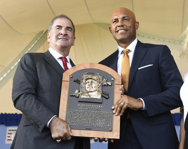 Tim Mead President of the National Baseball Hall Of Fame and Museum ,left, stands with inductee Mariano Rivera, New York Yankees pitcher during an induction ceremony at the Clark Sports Center on Sunday, July 21, 2019, in Cooperstown, N.Y. (AP Photo/Hans Pennink)