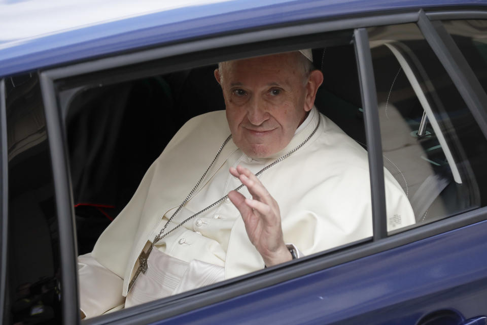 Pope Francis waves from a car as he leaves Dublin Castle at the end of his meeting with Irish Prime Minister Leo Varadkar, in Dublin, Ireland, Saturday, Aug. 25, 2018. Pope Francis is on a two-day visit to Ireland. (AP Photo/Matt Dunham)