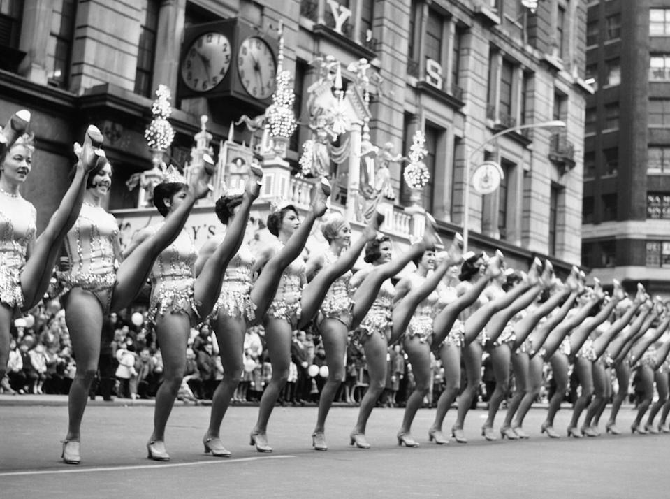 "The Radio City Rockettes perform during the 1964 <a href=""https://www.cntraveler.com/gallery/macys-thanksgiving-day-parade-through-the-years?mbid=synd_yahoo_rss"" rel=""nofollow noopener"" target=""_blank"" data-ylk=""slk:Macy's Thanksgiving Day Parade"" class=""link rapid-noclick-resp"">Macy's Thanksgiving Day Parade</a>. The first parade took place in 1924, complete with marching elephants borrowed from the <a href=""https://www.cntraveler.com/activities/new-york/central-park-zoo?mbid=synd_yahoo_rss"" rel=""nofollow noopener"" target=""_blank"" data-ylk=""slk:Central Park Zoo"" class=""link rapid-noclick-resp"">Central Park Zoo</a>."