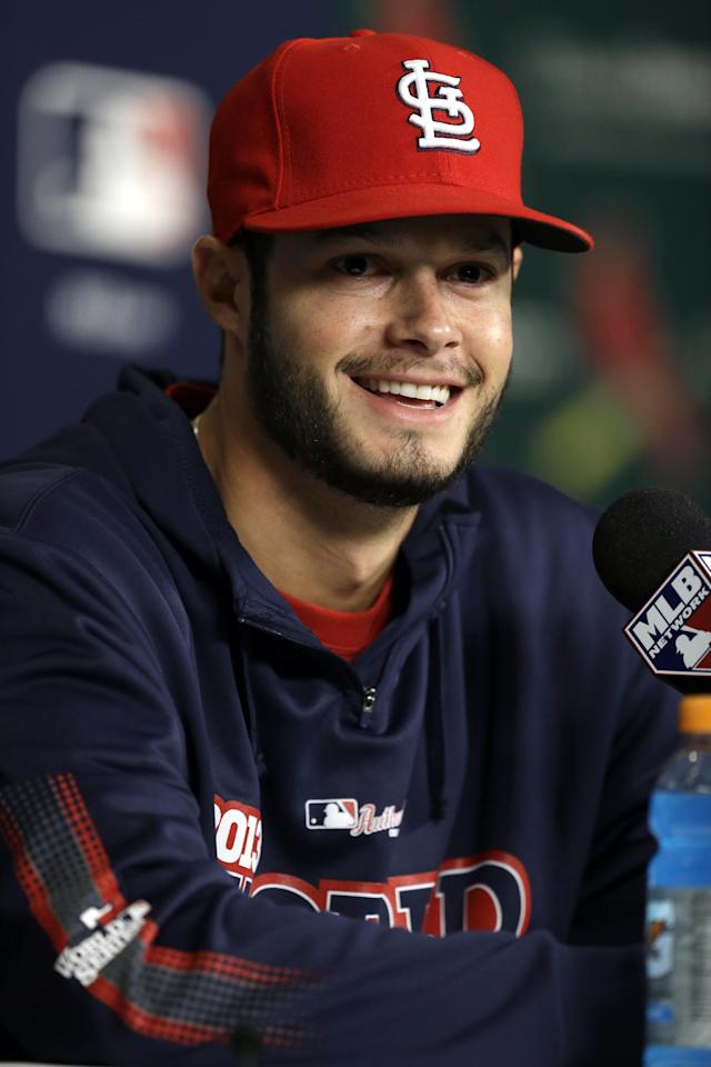 St. Louis Cardinals pitcher Joe Kelly smiles after hearing a question during a baseball news conference Friday, Oct. 25, 2013, in St. Louis. Kelly is set to start for the Cardinals when they play the Boston Red Sox in Game 3 of the World Series scheduled for Saturday in St. Louis. (AP Photo/Jeff Roberson)