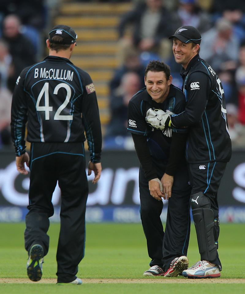 New Zealand bowler Nathan McCullum celebrates with Luke Ronchi and Brendon McCullum (left) after taking the wicket of England captain Alastair Cook during the ICC Champions Trophy match at the SWALEC Stadium, Cardiff.