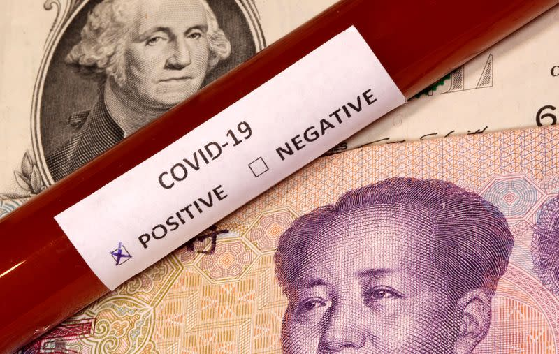 FILE PHOTO: Picture illustration of a test tube labelled with the coronavirus placed on U.S. dollar and yuan banknotes