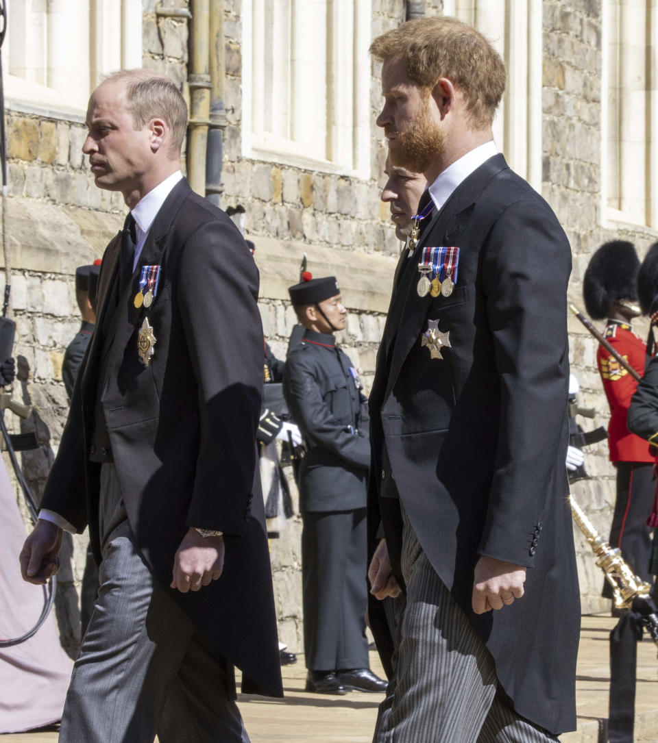 Prince William, left and Prince Harry follow the Land Rover Defender carrying the Duke of Edinburgh's coffin ahead of his funeral at Windsor Castle, in Windsor, England, Saturday April 17, 2021. Prince Philip died April 9 at the age of 99 after 73 years of marriage to Britain's Queen Elizabeth II. (Ian Vogler/Pool via AP)