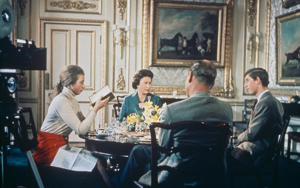 Queen Elizabeth II lunches with Prince Philip and their children Princess Anne and Prince Charles at Windsor Castle in Berkshire, circa 1969 - Hulton Archive