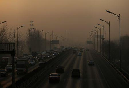 Vehicles drive on the 5th Ring Road in smog during morning rush hour on the fourth day after a red alert was issued for heavy air pollution in Beijing, China, December 19, 2016. REUTERS/Jason Lee