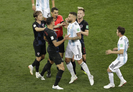 Argentina's Nicolas Otamendi (17) argues with Croatia's Dejan Lovren (6) during the group D match between Argentina and Croatia at the 2018 soccer World Cup in the Nizhny Novgorod stadium in Nizhny Novgorod, Russia, Thursday, June 21, 2018. (AP Photo/Michael Sohn)