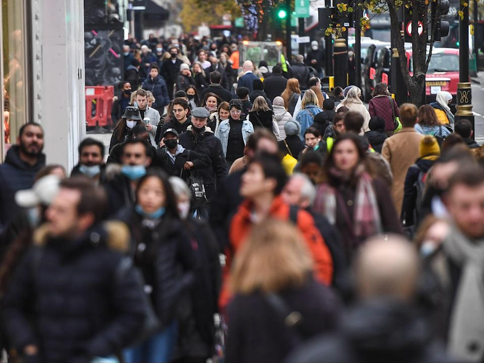 Crowds of shoppers are seen on Oxford Street, in London, on 2 December as England comes out of national lockdown (Getty)