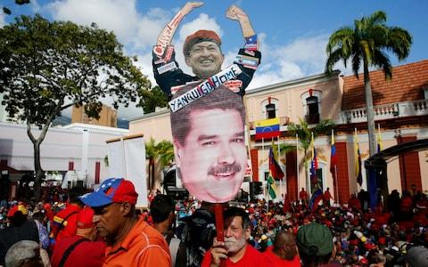 <span>Government supporters are celebrating the 20th anniversary of Hugo Chavez's rise to power</span> <span>Credit: Ariana Cubillos/AP </span>