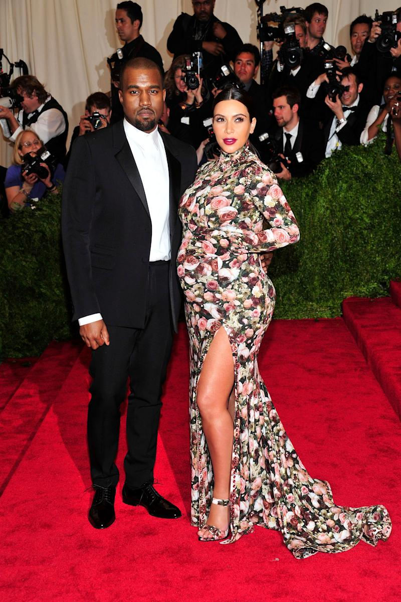 "Kanye West and Kim Kardashian attends The Metropolitan Museum of Art's Costume Institute benefit celebrating ""PUNK: Chaos to Couture"" on Monday May 6, 2013 in New York. (Photo by Charles Sykes/Invision/AP)"