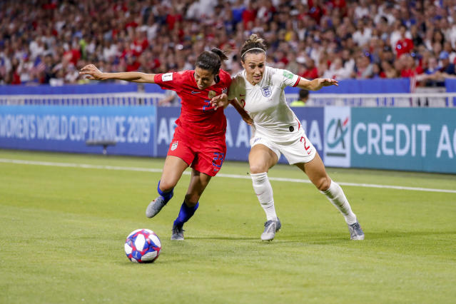Christen Press #23 of USA challenges Lucy Bronze #2 of England during the 2019 FIFA Women's World Cup France Semi Final match between England and USA at Stade de Lyon on July 2, 2019 in Lyon, France. (Photo by Catherine Steenkeste/Getty Images)
