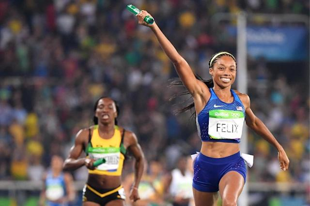 USA's Allyson Felix celebrates Team USA's victory as she croses the finish line in the women's 5000m Final (AFP Photo/Olivier Morin)