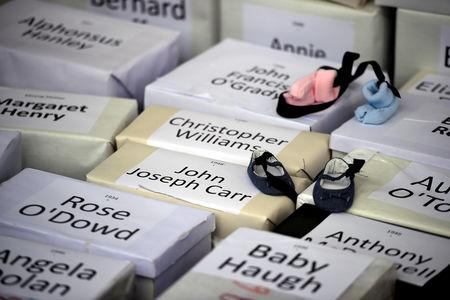 FILE PHOTO: Funeral boxes, each representing a dead child, are placed together at a procession in remembrance of the bodies of infants discovered in a septic tank, in 2014, at the Tuam Mother and Baby Home, in Dublin, Ireland, October 6, 2018. REUTERS/Clodagh Kilcoyne/File Photo