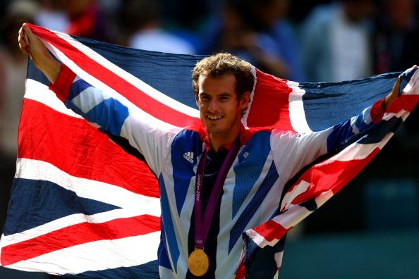 LONDON, ENGLAND - AUGUST 05:  Andy Murray of Great Britain poses with his gold and silver medals holding a union jack after the medal ceremony for the Mixed Doubles Tennis on Day 9 of the London 2012 Olympic Games at the All England Lawn Tennis and Croquet Club on August 5, 2012 in London, England.  (Photo by Paul Gilham/Getty Images)