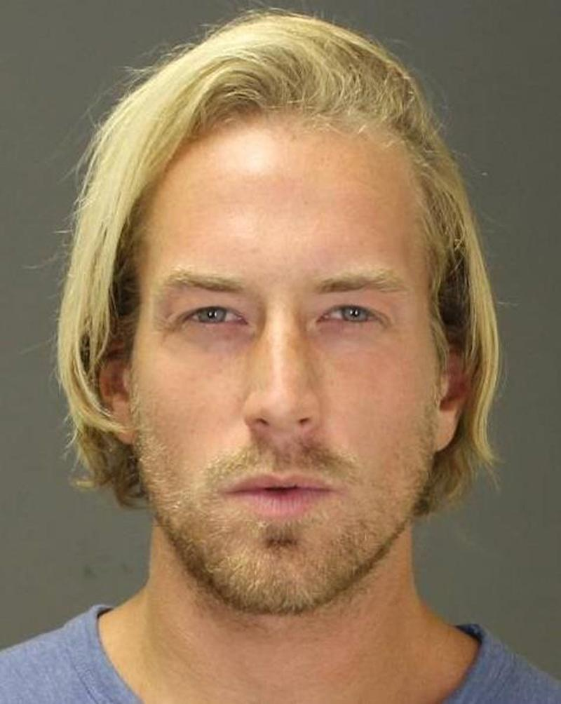 This Sept. 2014 file photo provided by the Suffolk County District Attorney's Office shows Thomas Gilbert Jr., after his arrest on Sept. 18, 2014 in the town of Southampton, N.Y., on a misdemeanor charge.