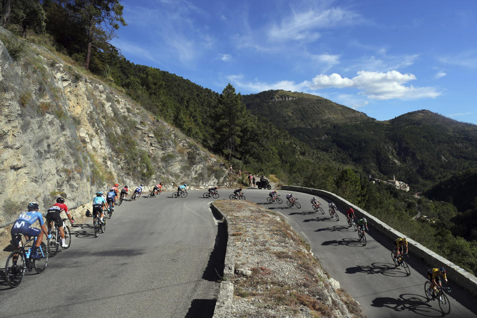 The pack speeds down Turini pass during the second stage of the Tour de France cycling race over 186 kilometers (115,6 miles) with start and finish in Nice, southern France, Sunday, Aug. 30, 2020. (AP Photo/Thibault Camus)