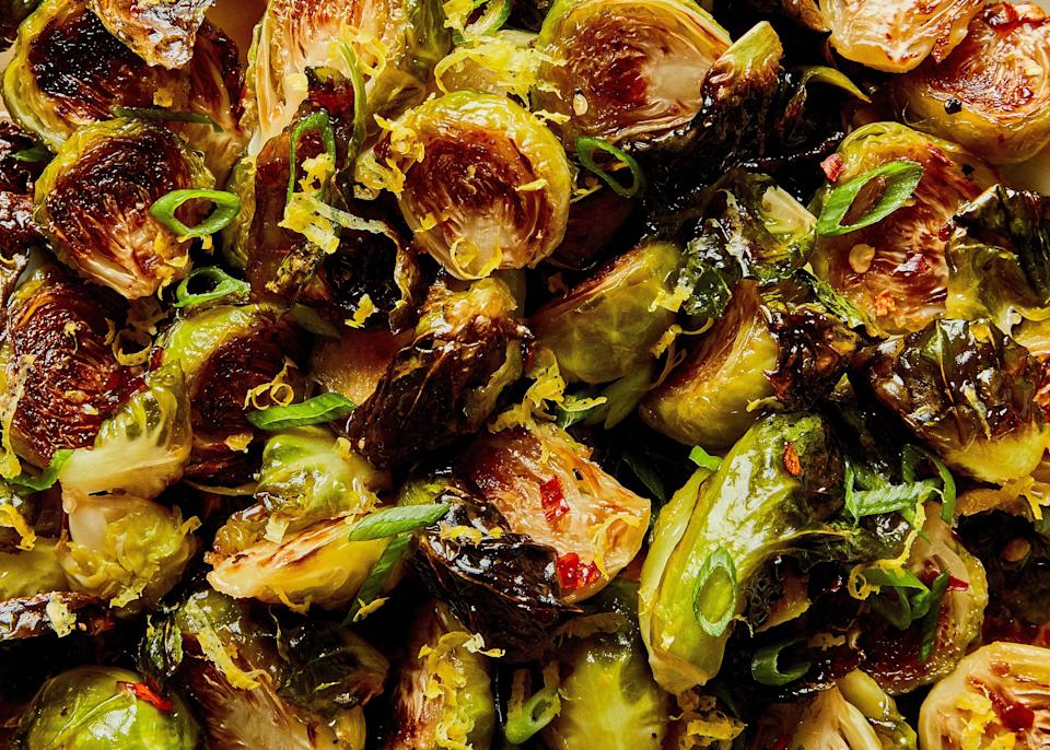 """These roasted Brussels sprouts get a fair amount of spice from the crushed red pepper flakes, which cuts through the acidity and sweetness of the glaze, but if you're spice-averse, feel free to leave them out! <a href=""""https://www.epicurious.com/recipes/food/views/roasted-brussels-sprouts-with-warm-honey-glaze?mbid=synd_yahoo_rss"""" rel=""""nofollow noopener"""" target=""""_blank"""" data-ylk=""""slk:See recipe."""" class=""""link rapid-noclick-resp"""">See recipe.</a>"""