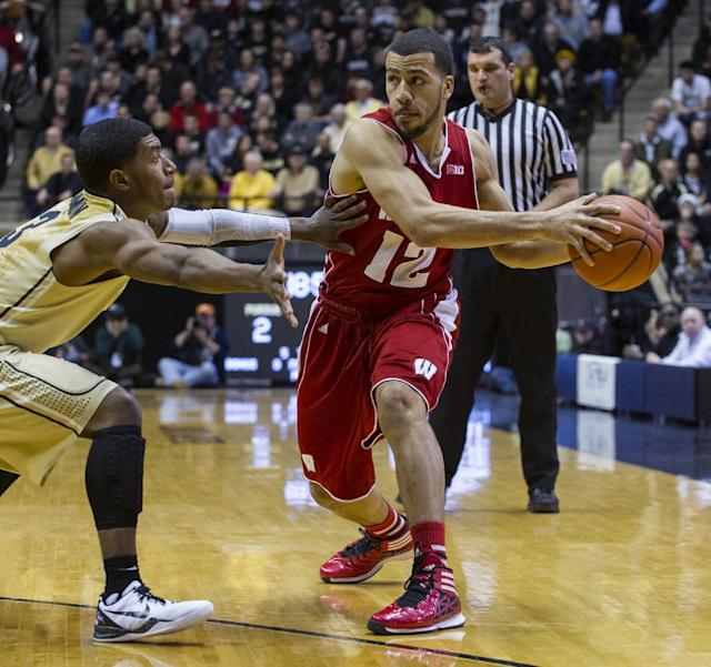 Wisconsin's Traevon Jackson (12) is pressured by Purdue's Ronnie Johnson (3) in the first half of an NCAA college basketball game, Saturday, Jan. 25, 2014, in West Lafayette, Ind. (AP Photo/Doug McSchooler)
