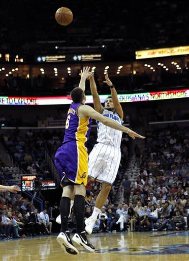 New Orleans Hornets guard Marco Belinelli (8) shoots a three point attempt against Los Angeles Lakers forward Josh McRoberts (6) in the second half of an NBA basketball game in New Orleans, Monday, April 9, 2012. The Lakers won 93-91. (AP Photo/Gerald Herbert)