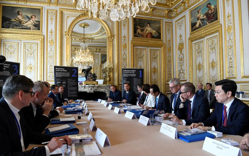 """Delegates gather during a """"Tech For Good"""" summit in Paris, Wednesday, May 15, 2019. Several world leaders and tech bosses are meeting in Paris to find ways to stop acts of violent extremism from being shown online. (Bertrand Guay, Pool Photo via AP)"""