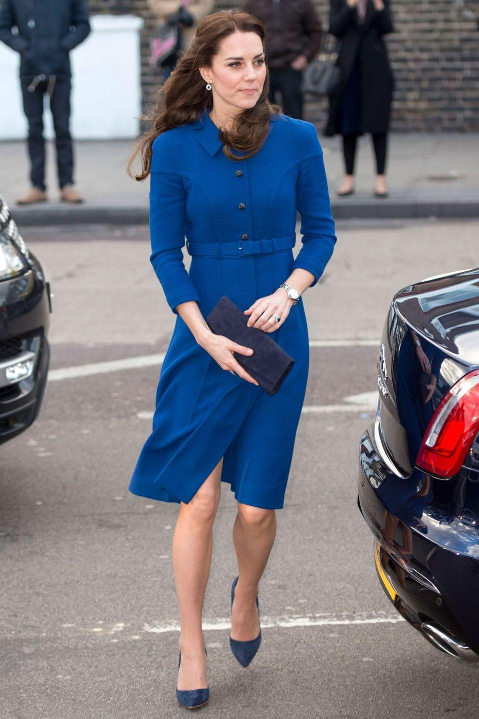 <p>Middleton wears a blue belted coatdress by Eponine, suede navy heels, suede clutch and pendant earrings while visiting the<br><br><br><br><br><br><br><br><br><br><br><br><br><br><br><br><br><br><br><br><br><br><br>Anna Freud Centre's Early Years Parenting Unit in Holloway, north London.<br></p>