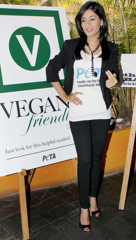 Amirta Rao supports Peta in her classic black pair and jacket.