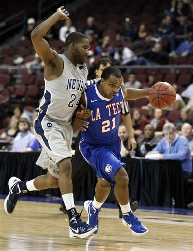 Louisiana Tech guard Kenyon McNeail (21) passes drives past Nevada guard Deonte Burton (24) during their NCAA college basketball game in the Western Athletic Conference tournament Friday, March 9, 2012, at The Orleans Arena in Las Vegas. (AP Photo/Eric Jamison)