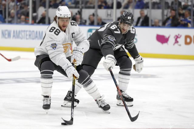 Boston Bruins forward David Pastrnak (88) moves the puck against Vegas Golden Knights forward Max Pacioretty (67) in the NHL hockey All Star final game Saturday, Jan. 25, 2020, in St. Louis. Pastrnak was named the most valuable player of the games (AP Photo/Jeff Roberson)