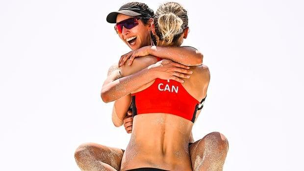 Toronto's Melissa Humana-Paredes, left, and Sarah Pavan of Kitchener, Ont., will be vying for a seventh beach volleyball titletogether in their 12th World Tour final when they faceTalita Antunes and Taiana Lima of Brazil on Tuesday at 5 p.m. ET in Cancun, Mexico. (Submitted by FIVB - image credit)