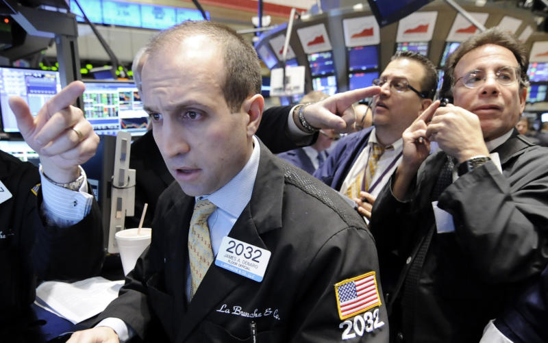 FILE - In a Jan. 30, 2009 file photo traders work on the floor of the New York Stock Exchange.  A two-day rally that sent stocks soaring last week fizzled out Monday July 30, 2012.  (AP Photo/Richard Drew, file)