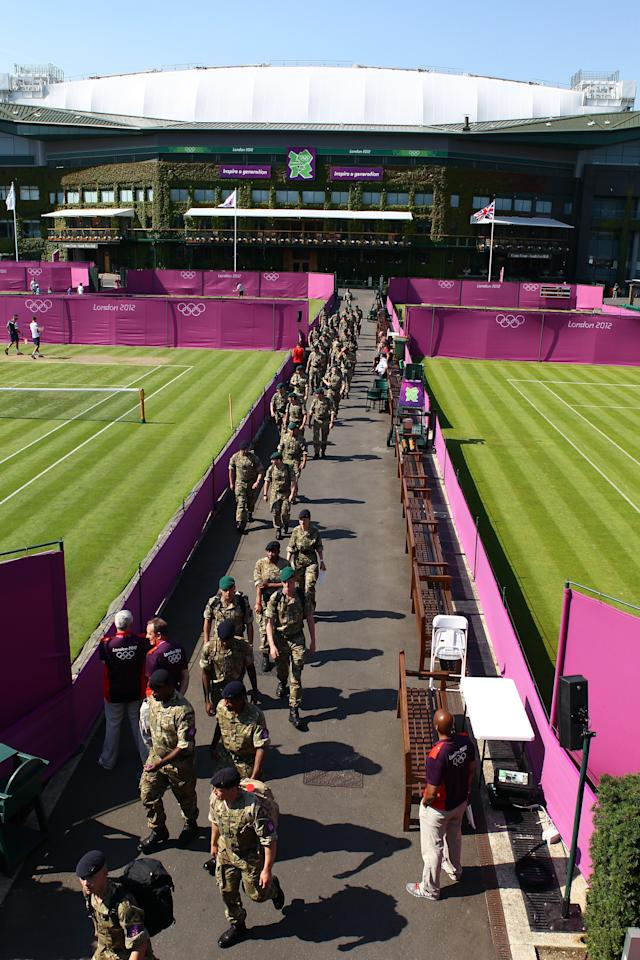 LONDON, ENGLAND - JULY 26: Members of the British army patrol the grounds during the practice session ahead of the London 2012 Olympic Games at the All England Lawn Tennis and Croquet Club in Wimbledon on July 26, 2012 in London, England. (Photo by Clive Brunskill/Getty Images)